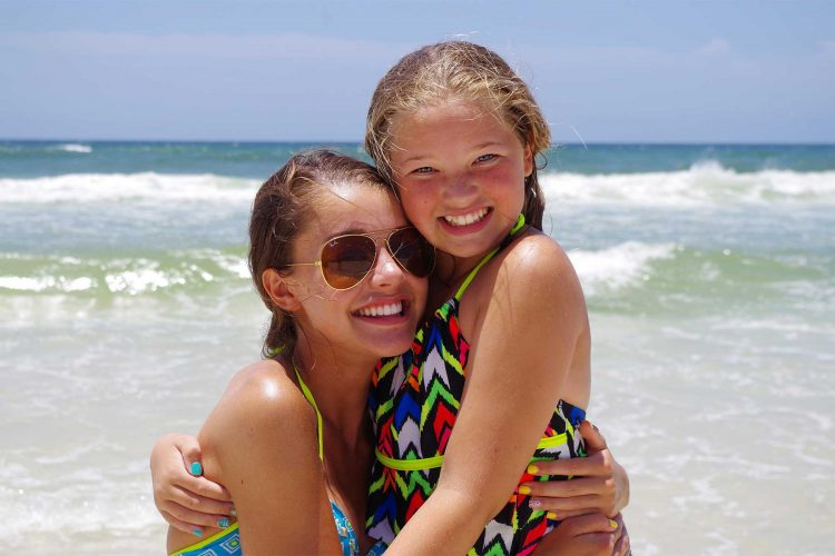 Mom and daughter having fun on the beach - We offer daytime beach photos in Panama City Beach, Destin, Fort Walton and Miramar Beach
