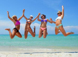 girls jumping in the air for an action shot photo