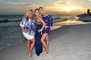 three women smiling for the camera in PCB