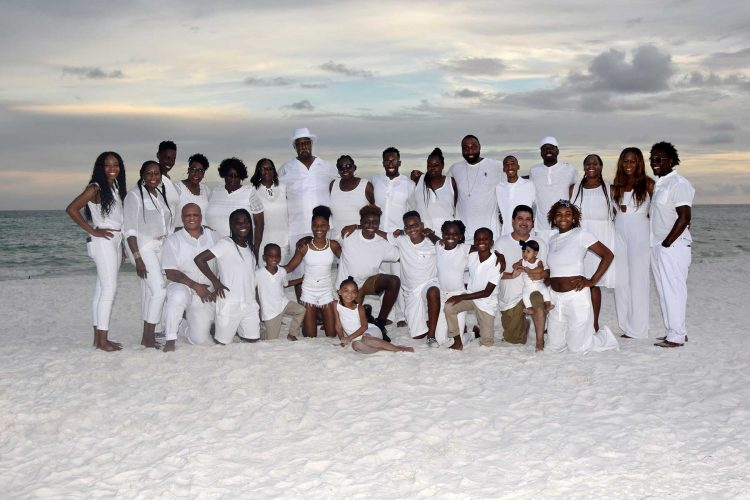 large family reunion group photo on the beach