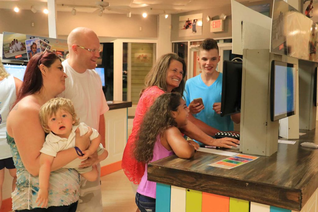 happy family choosing their photos