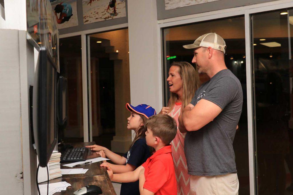 Family choosing photos at our main studio location in Panama City Beach, FL