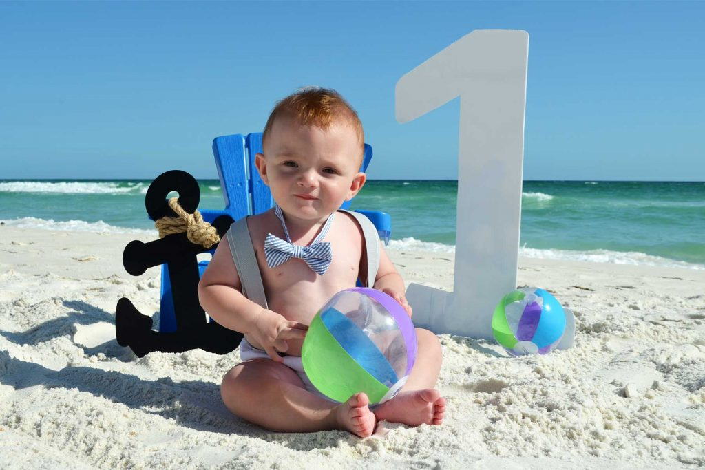 baby's first birthday photo on the beach