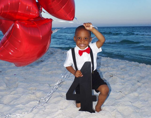 Little boy with balloons in special occastion photo