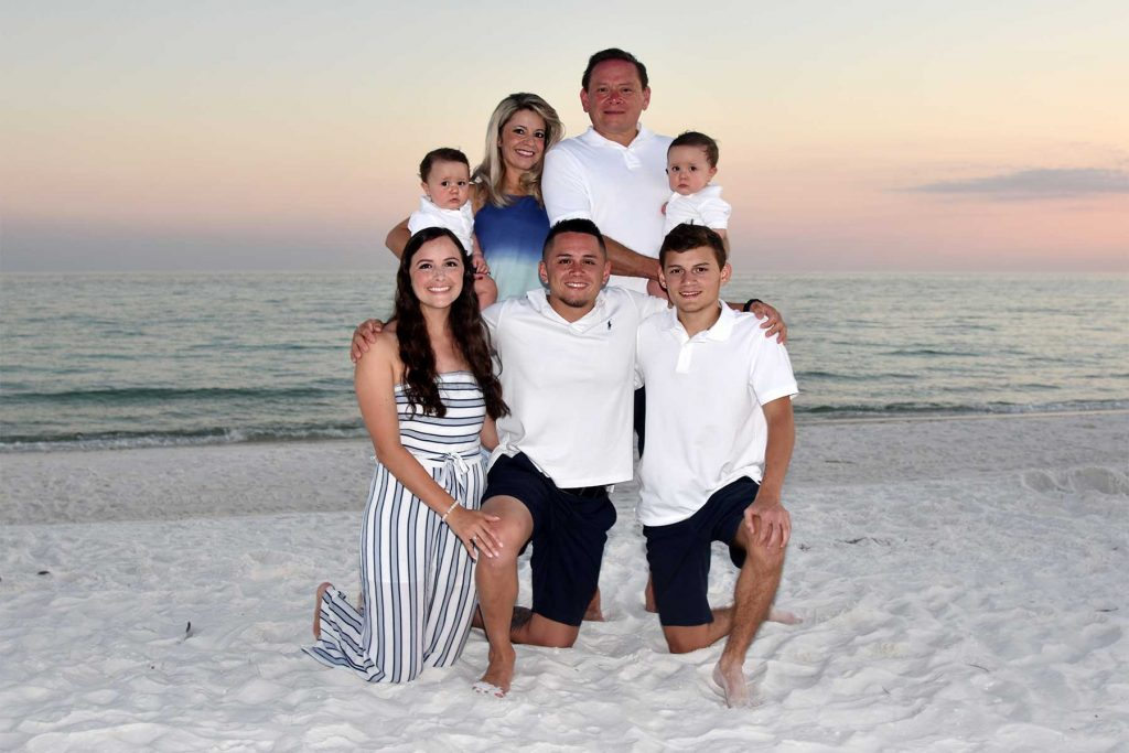 Baby and family at sunset