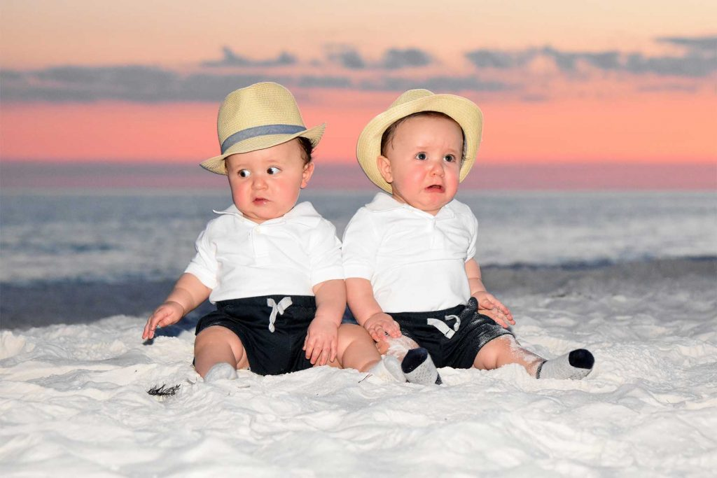 Adorable twin boys in hats