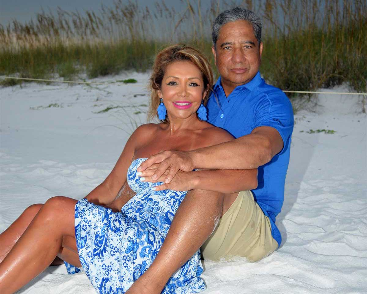 couple posing on the sand