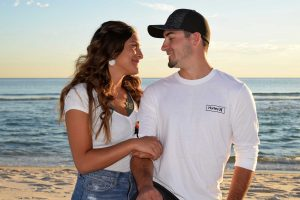 Photographer in Panama City Beach snaps a hug of this young couple.