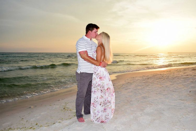 Couple kissing in their sunset beach photo on Panama City Beach