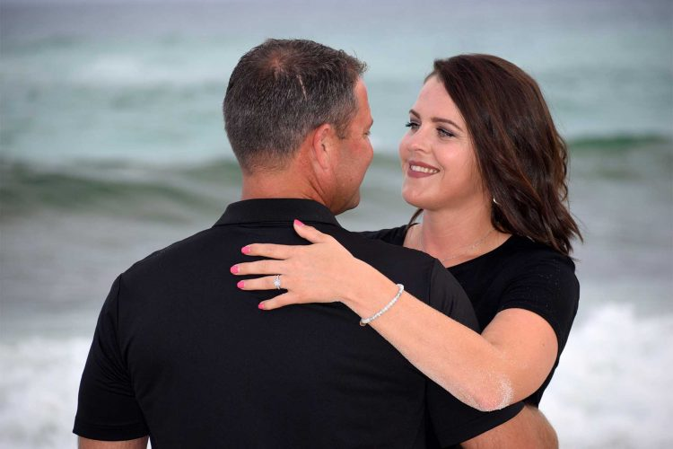 Couple looking into each other's eyes in their engagement photo