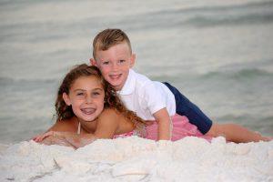 siblings posing on the shore