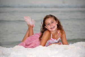 girl posing with sandy feet
