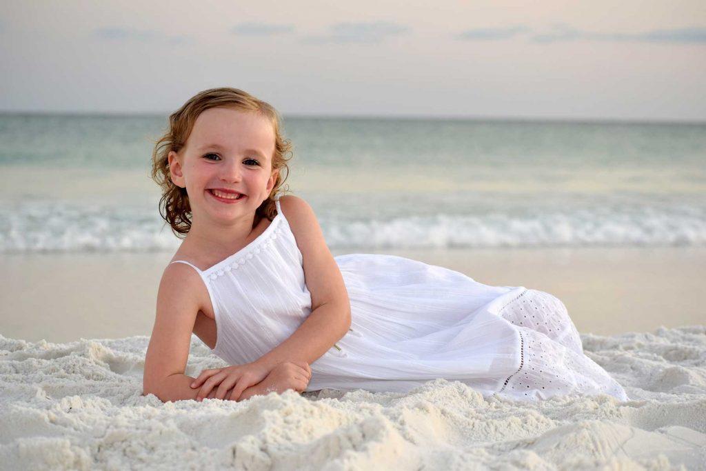 Little girl posing for sunset photo