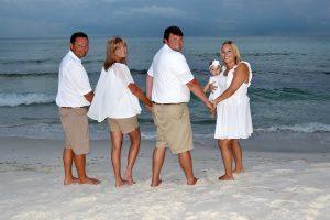 family posing on the beach