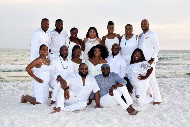 Large group posing for a beach photo. We offer beach photos in Destin, Ft Walton, Miramar and PCB.