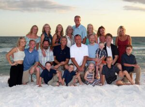 Large group photo at sunset in Panama City Beach