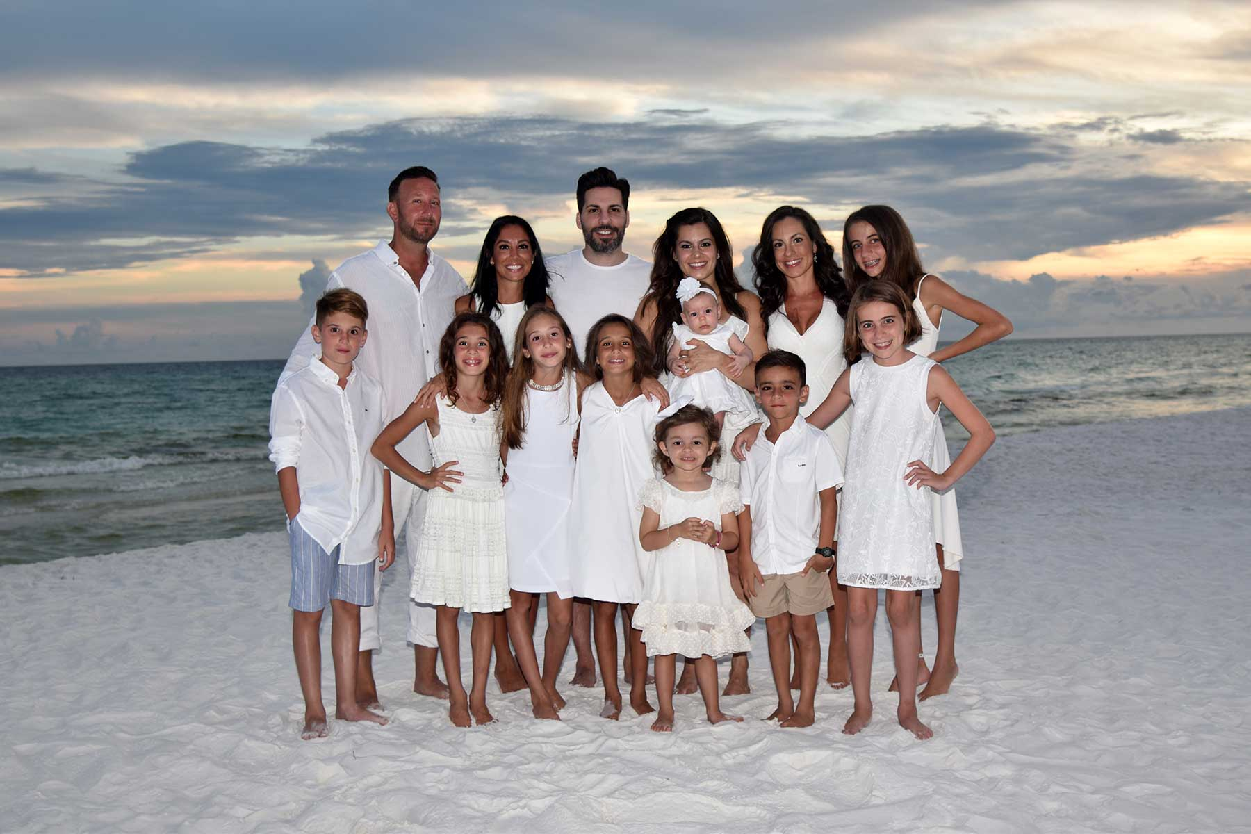 large family smiling for our PCB photographer
