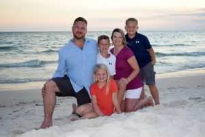 Child number 4 is being welcome by this loving family during thier photoshoot in PCB.