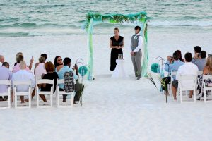 Our photographer captured this photo of the groom waiting at the alter for his bride.. This photo is from a wedding on the beach in PCB FL.