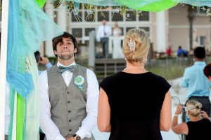 Our photographer shot this photo of the groom waiting for the bride to come down the aisle. Our photographers are available for formal and casual wedding photos in Panama City Beach, Destin, Ft Walton Beach, and Miramar Beach FL.