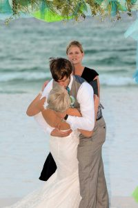 A photo of the groom kissing the bride.