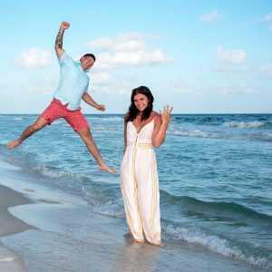 Photo of a surprise proposal in Panama City Beach - beautiful blue water, a happy couple and the engagement ring.