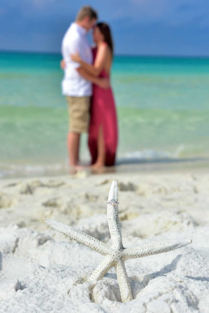Panama City Beach photographer makes sure to get a great photo of the ring!