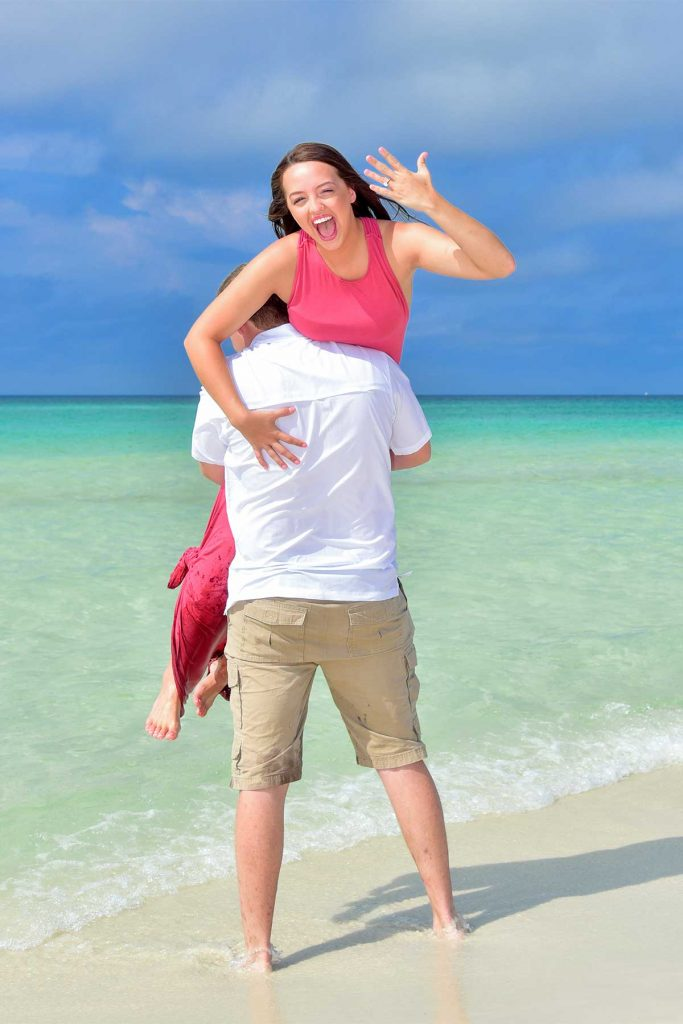Photographer in PCB includes a fun pose for a young couple.