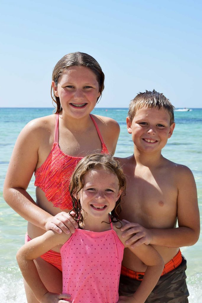 3 kids smiling