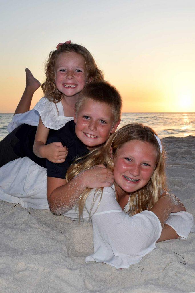 closeup of kids on beach at sunset