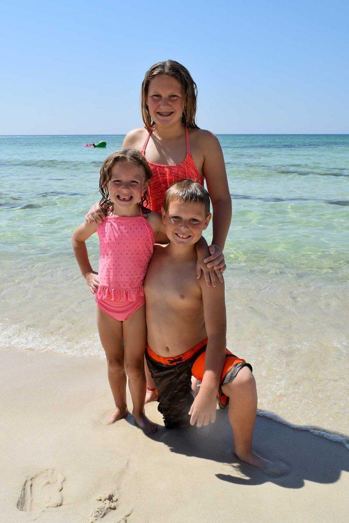 kids posing on the beach