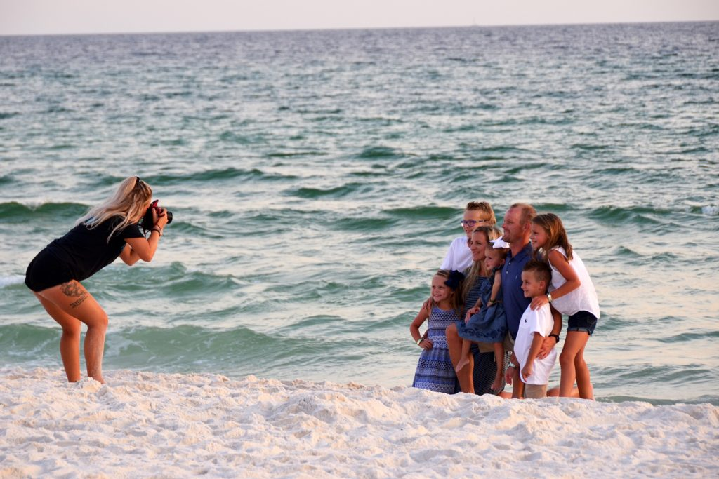 Panama City Beach photographer Stazia snapping a photo of a family