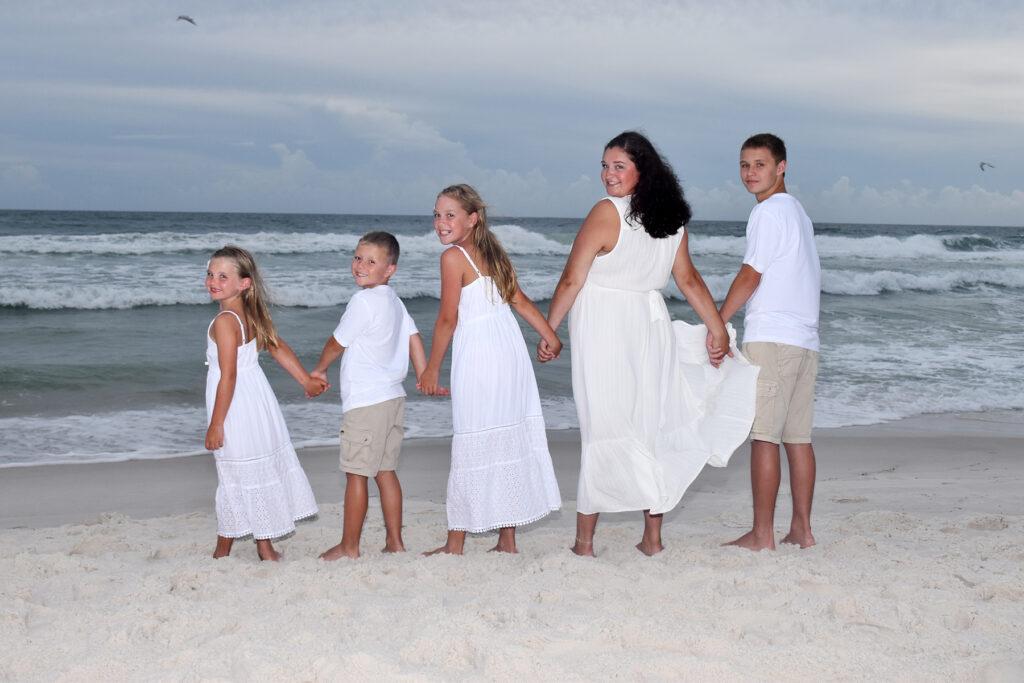 Kids posing for sunset beach photo
