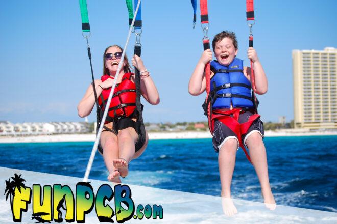 happy family parasailing