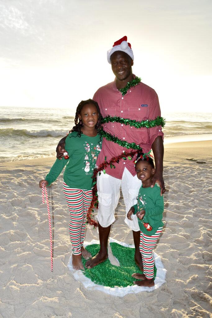 family Christmas photo on the beach