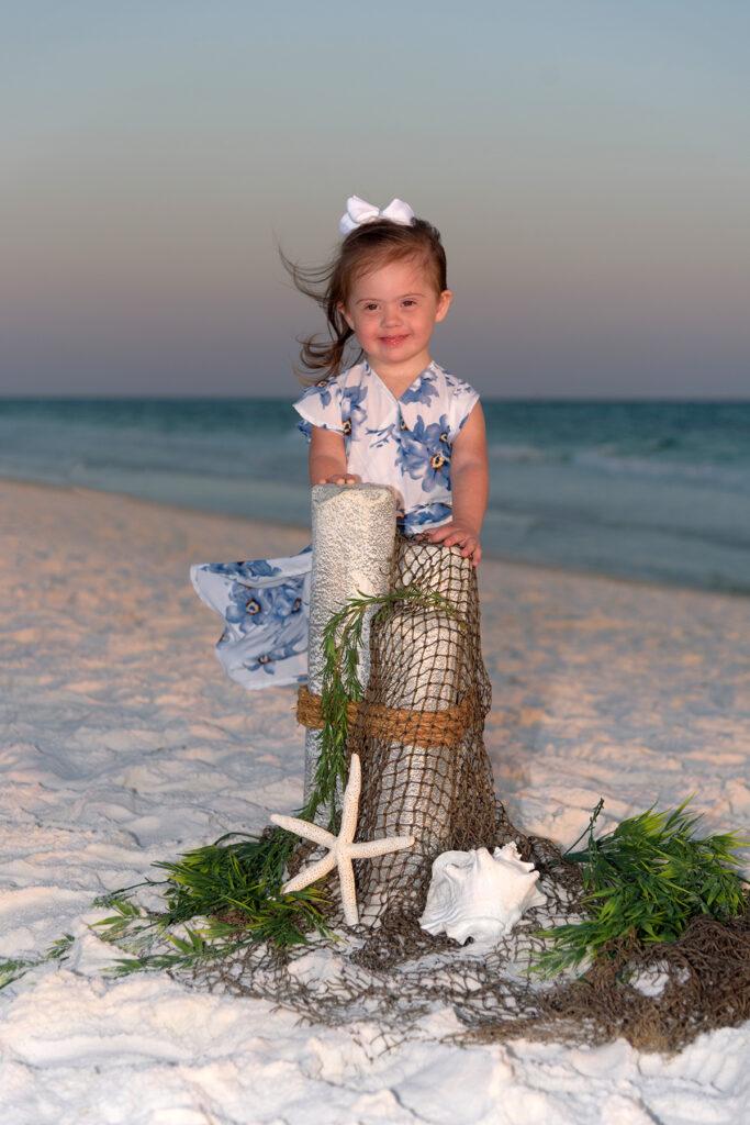 Little girl posing on Destin beach at dusk.